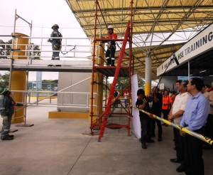 After the formal opening, SITE trainers lead the attendees on a tour of the center. In photo, [from r-l] Petilla and Quiniones watch a demonstration on proper and safe working from heights.