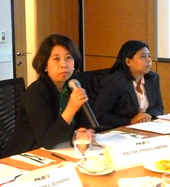 Maria Teresa Habitan, Department of Finance Assistant Secretary, facilitates the meeting.