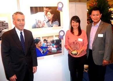 "Taking a photo beside SIKAP's ""Wired for Success"" are [from left] United States Ambassador to the Philippines Philip Goldberg, Malampaya Project Communications Advisor Christine Guison and Shell Finance Director Jeng Pascual."