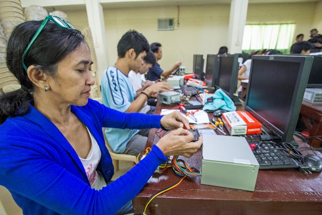 "SIKAP's ""Wired for Success"" Winner: Livelihood Category Photographer: Mario H. Babiera Date Taken: November, 2013  Brief Description: A housewife learns computer electronics wiring at Matain, Subic, Zambales"