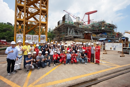 University students tour the MP3 Fabrication Yard facilities with [leftmost] Shell Upstream Communications Manager Paulo Gavino, [4th from right, kneeling] Shell HR Country Recruitment Manager Janice Benavidez-Pamplona, [from rightmost] Keppel Subic Shipyard President Leong Kok Weng and MP3 Company Site Representative Nathan Stephenson. Behind them can be seen the country's first offshore gas platform being built.